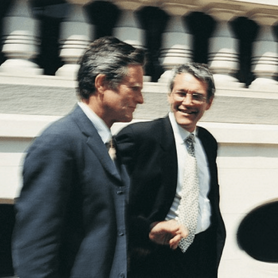 Two mature businessmen walking