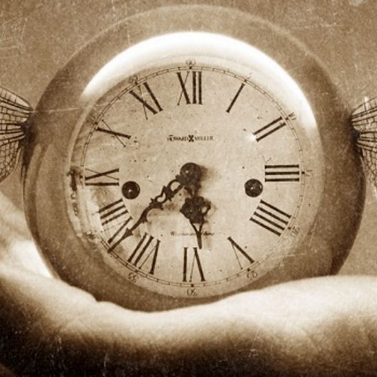 Sepia photo of a timepiece in a hand